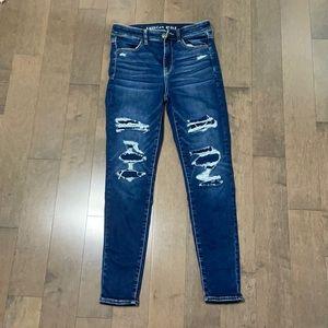 Dark blue ripped jean